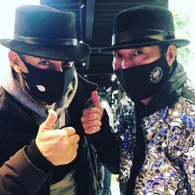 Stopped by @rynshu1217 to say a quick hello and ended up taking this awesome photo with my favorite designer!  The mask and hat is his originals... All his new 2020 collection from his recent fashion show were all on display. The man is a genius. #thumbsup